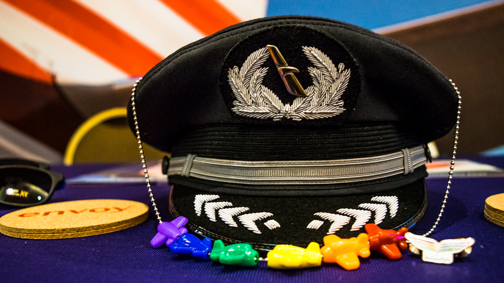 Envoy/American pilot hat with rainbow plane necklace