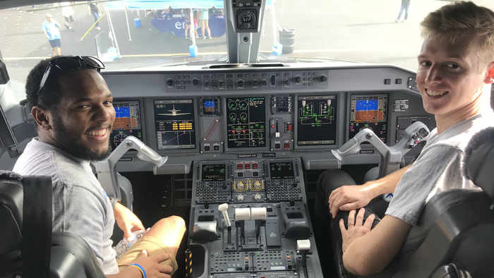 Keith with a friend on the flight deck of an Embraer 175 operated by Envoy at the Homestead Air Show in 2018.