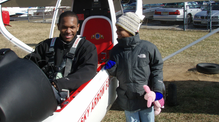Cadet Keith Taylor with his little brother after his discovery flight in 2014.