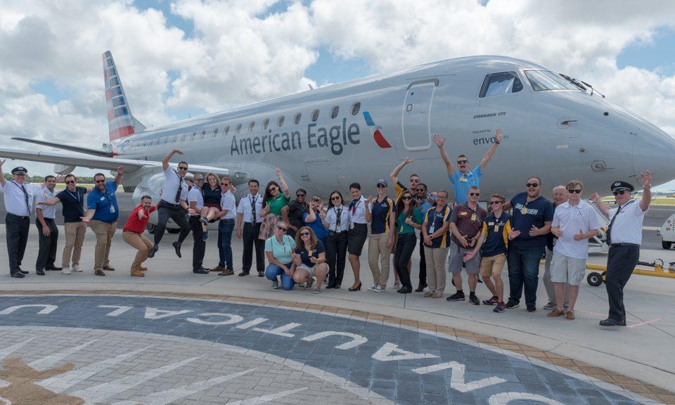 Team Envoy poses in front of an E175 at ERAU Daytona