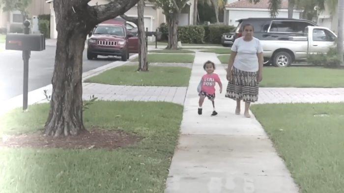 "Kristen walks on a neighborhood sidewalk with her ""abuelita""."